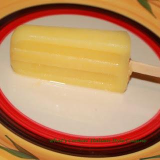 Boozy Pineapple Colada Popsicle.