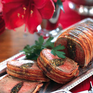 Bacon-Wrapped Beef Tenderloin with Herb Stuffing.