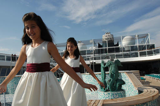 Junior-Cruisers-Kids-on-Deck-Formal-Night - Kids can dress up and have fun on deck during Formal Night with the Junior Cruisers on a Crystal cruise.