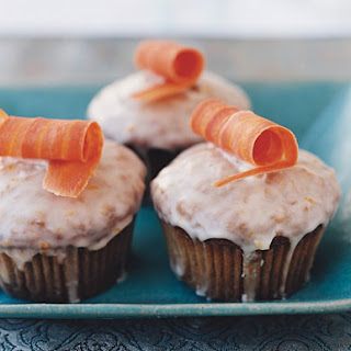 Carrot Cupcakes with Orange Icing.
