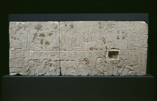 Part of a tomb wall with a funeral procession