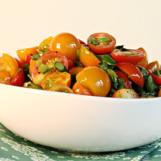 Flash-Sautéed Cherry Tomatoes with Garlic Scapes and Chives.