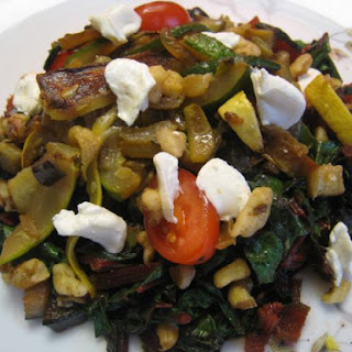 Warm Swiss Chard Salad in Brown Butter with Sauteed Vegetables, Goat Cheese, and Walnuts.