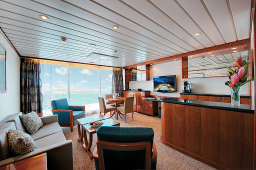 Owner's Suite 7002 on the Paul Gauguin features butler service and can accommodate up to four guests by adding two berths with a queen-size sofa bed. The bathroom includes a full-size tub and dressing area.
