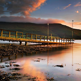 """Sunset at killowen Point, Carlingford Lough. Undoubtedly the most dreadful disaster in the lough was recorded in 1916 when the ferry steamer """"Connemara"""", grossing 1100 tons, was in a collision with the SS Retriever carrying a cargo of coal. Both ships sank with the loss of 97 lives. Only one person survived. by Leslie Hanthorne - Landscapes Sunsets & Sunrises"""