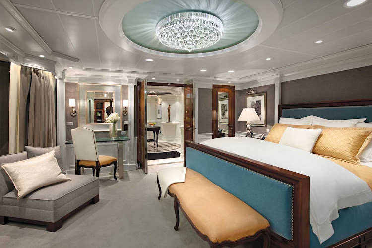 Sail in grand style: A look at the bedroom and its stylish light fixture inside the Owners Suite of Oceania Riviera.