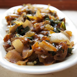 Sautéed Bok Choy with Caramelized Onions, Golden Raisins, and Toasted Pine Nuts