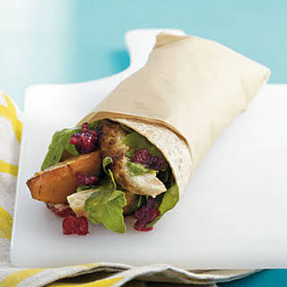 Grilled Chicken, Pear, and Arugula Wrap with Cranberry Vinaigrette.