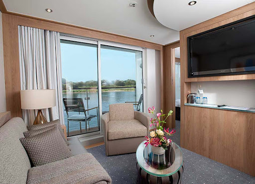 Viking-Longship-Veranda-Suite-lounge - Kick back with a glass of wine and Hollywood movie in the comfort of your own suite aboard your Viking Longship during your voyage along Europe's waterways.