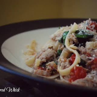 Pasta with Sausage, Tomatoes and Arugula.