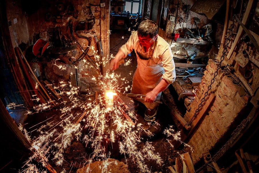 Blacksmith by Mirela Savu - People Professional People ( lights, blacksmith, working man, horseshoes, sparks )