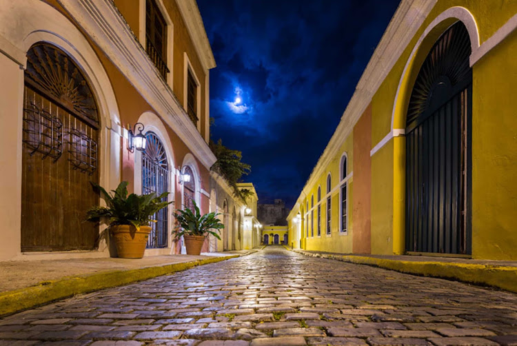 The glistening streets of Old San Juan bathed in moonlight.
