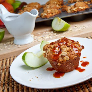 Cheesecake Stuffed Apple Muffins with Streusel Topping and Caramel Sauce.