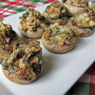 Artichoke & Sun-Dried Tomato Stuffed Mushrooms.