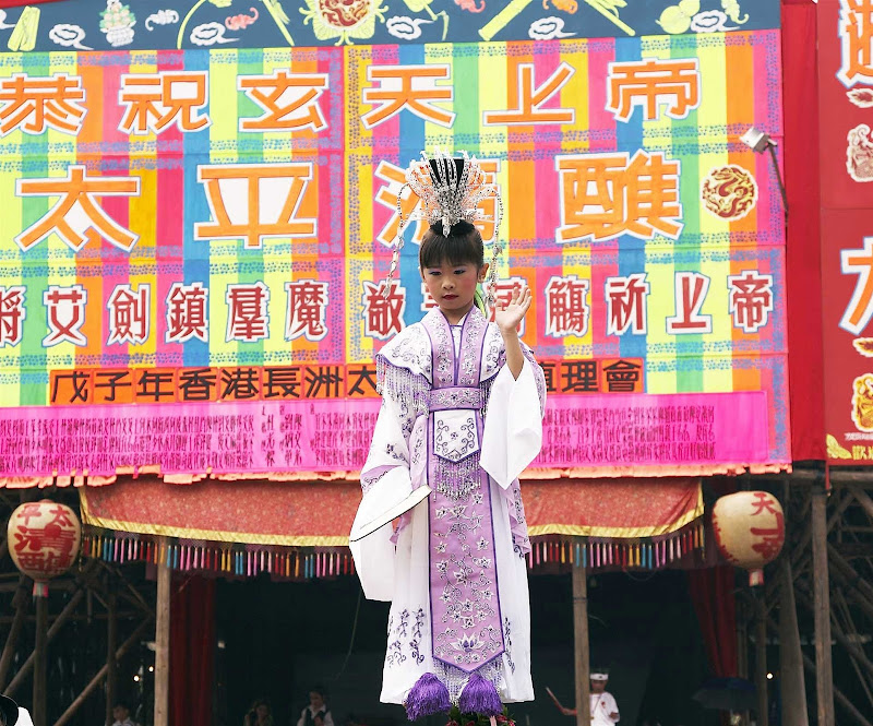 A girl performs at the Bun Festival in Hong Kong.