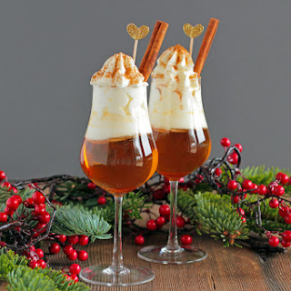 Hot Apple Amaretto Shot with Whipped Cream and Cinnamon.