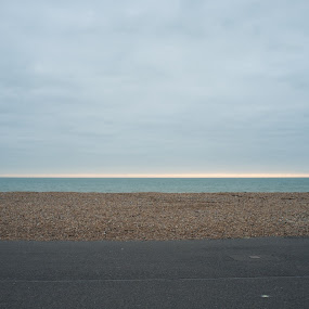 Half price to you guvnor by Adrian Stock - Landscapes Beaches ( clouds, worthing, empty, sea, pebbles, beach )