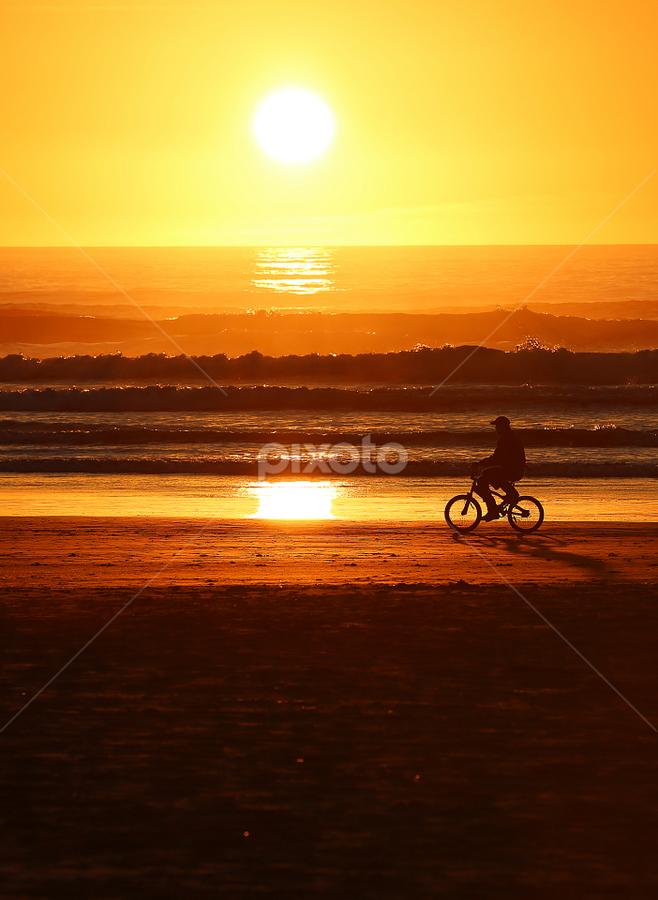 Beach Biker by Bill Waterman - Landscapes Sunsets & Sunrises ( waves, sunset, beach, seascape, landscape, people, ocean view )