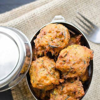 Zucchini and Onion Bhajis (Indian Spiced Zucchini and Onion Fritters or Pakoras).