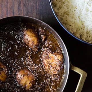 Iranian/Persian Fesenjoon (walnut and pomegranate dish) with Rice.