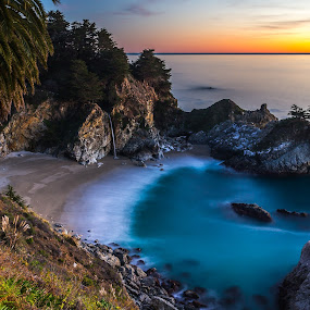 Into the Pacific by Mike Lindberg - Landscapes Waterscapes ( pacific coast, big sur, california, waterfall, pacific ocean, ocean, beach, palm tree, pfieffer beach, mcway falls, sunset, mcway, long exposure, california coast )