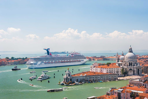 Carnival-Freedom-in-Venice - Carnival Freedom in Venice, Italy. The ship now cruises to the Caribbean, including the Caymans, Aruba, Curacao, Belize and the Bahamas.