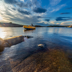 Low angle by Bent Velling - Landscapes Waterscapes ( clouds, water, canon 6d, s, sigma 12-24mm, dusa, boat, rocks, norway, sarpsborg )