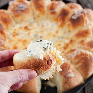 Warm Skillet Bread with Artichoke Spinach Dip.