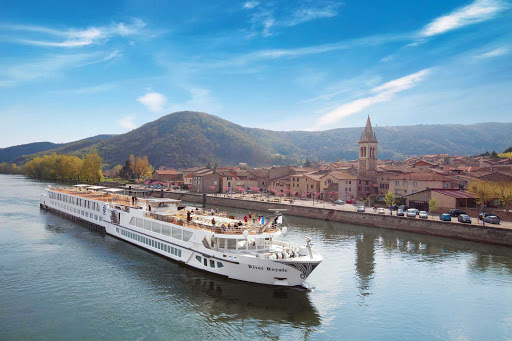 S.S. Bon Voyage (formerly River Royale), one of Uniworld's most luxurious cruise ships, sails through a historic villa in the south of France.