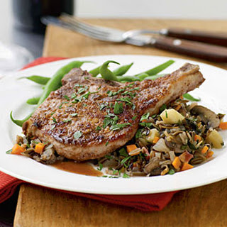 Walnut-Crusted Pork Chops with Autumn Vegetable Wild Rice.