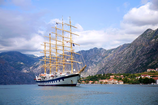Royal-Clipper-in-Kotor-Montenegro - Royal Clipper arrives in Kotor, Montenegro, as part of a Mediterranean itinerary.  The ship carries just 227 guests and boasts 19,000 square feet of open deck and three swimming pools.