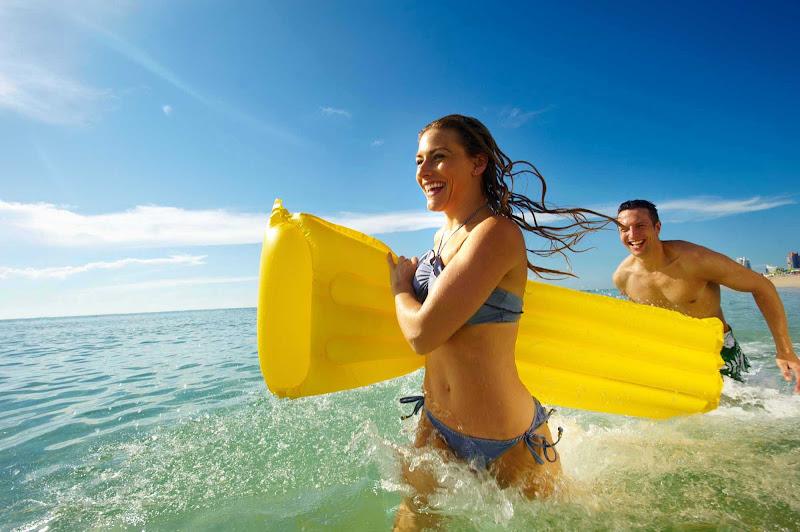 Fun along the beach during a shore excursion in the tropics on a Royal Caribbean cruise.