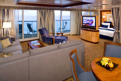 Jewel-of-the-Seas-Owners-Suite - Luxury accommodations on Jewel of the Seas include the Owner's Suite, which offers a queen-size bed, private balcony, separate living area and other amenities.