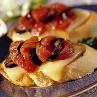 Tomato Crostini with Fontina Cheese.
