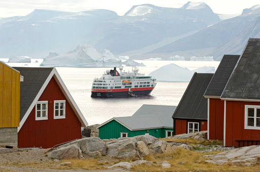 Hurtigruten-Fram-in-Greenland - The 278-passenger Fram, the smallest, newest ship in Hurtigruten's fleet, sails past the small island of Uummannaq on the west coast of Greenland.