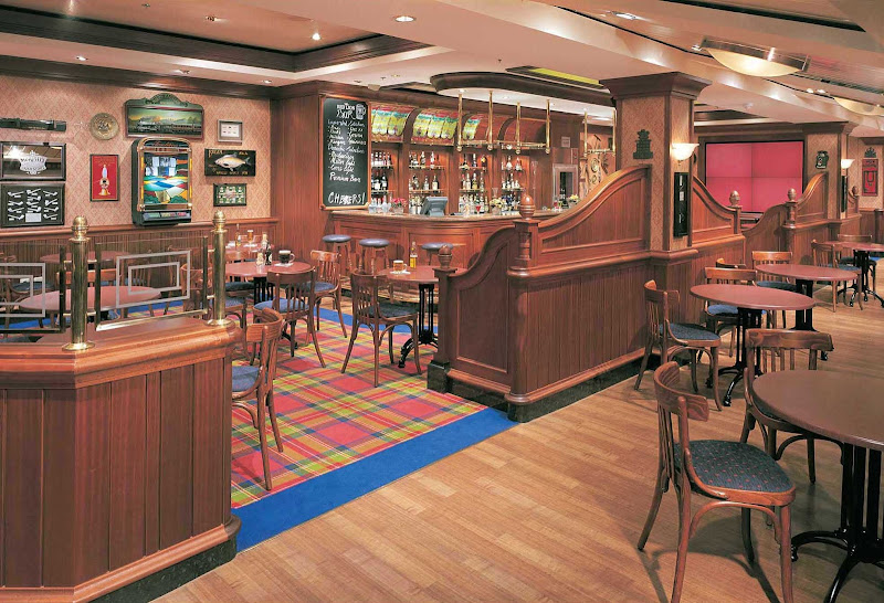 The Red Lion Pub, a traditional English pub on deck 7 of Norwegian Star, offers drinks, a pool table and entertainment on large-screen TVs.