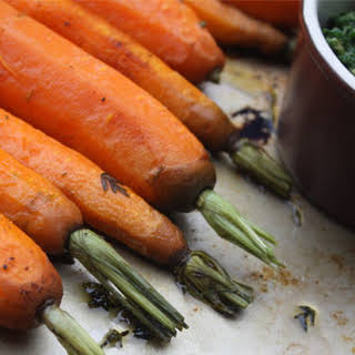 Roasted Baby Carrots with Almond-Carrot Top Pesto.