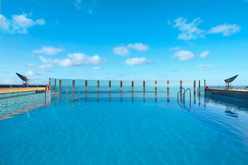 MSC-Divina-Garden-Pool - Soak up the sun and the scenery in MSC Divina's turquoise blue infinity pool during your cruise.