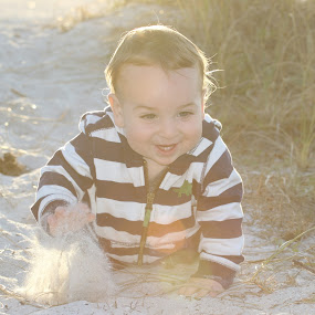 Beach Crawler by Jared Lantzman - Babies & Children Children Candids ( sand, playful, beach, stripes, sun, playing, happy, happy warm, baby, smile, crawling, fast, boy, smiling )