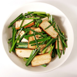 Stir-fry Chive Blossoms with Pressed Tofu (豆幹炒韭菜花).
