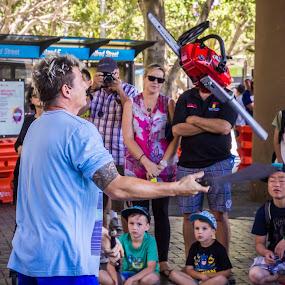 Chainsaw Juggler by Amro Labib - People Musicians & Entertainers ( skills, relax, street, street art, holidays, risky, stunt, city, happy, action, smile, portraits, sydney, art, juggle, fun, kids, portrait, street photography, holiday, portraiture, portait, australia, summer, hot, day, fast, stunning, street scenes, daylight )