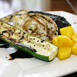 Grilled Vegetables With Polenta Croutons Drizzled With A Balsamic Reduction.