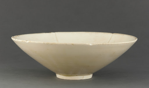 Ding ware bowl with molded lotus design in bottom