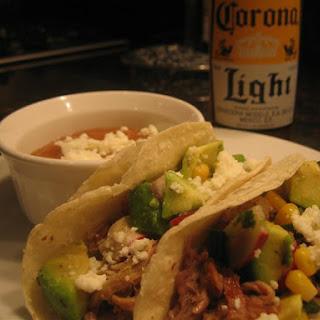 Slow Cooked Pork Carnita Tacos with Corn and Avocado Salsa.