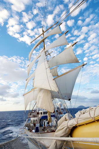 Royal-Clipper-sails - Feel the wind fill the sails of Royal Clipper. The ship has five masts that fly 42 lovely sails with a sail area of 56,000 square feet.