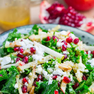 Apple and Pomegranate Quinoa and Kale Salad with Feta in a Curried Maple Dijon Dressing.