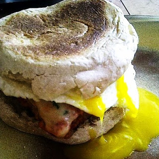 Veal Parmesan Morning Sandwich with a Fried Egg on Whole Wheat English Muffin.