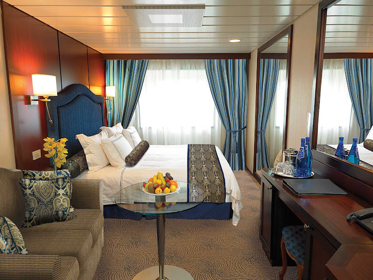 The C Level Deluxe Ocean View staterooms on Oceania Insignia contain custom-designed furnishings, queen or two twin bed accommodations, spacious seating area, vanity desk and breakfast table. At 165 square feet, they're located on decks 4,6 and 7.