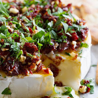 Baked Brie Recipe with Sun-Dried Tomatoes.