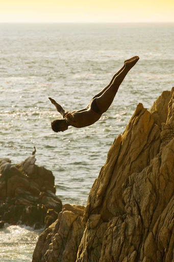 Acapulco-cliff-diver - One of the famed cliff divers (La Quebrada) of Acapulco.